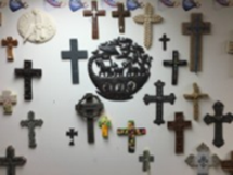 08.04.2016 Gift Shop Wall of Crosses.png